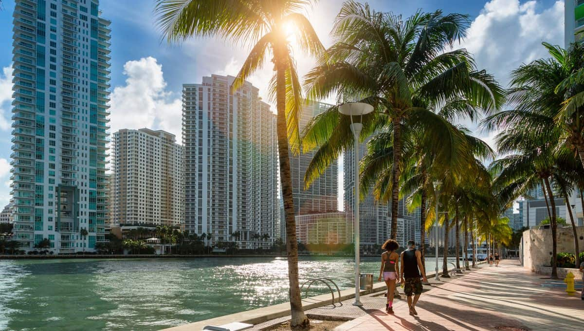 Downtown_Miami_People_Walking_along_Miami_River_terrenosnaflorida-com_shutterstock_1254424708_1200x680