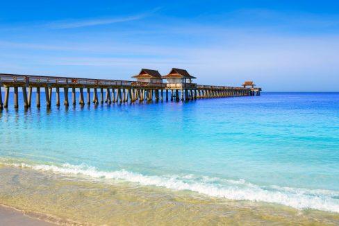 Naples_Pier_and_beach_in_florida_USA_sunny_day_4_terrenosnaflorida-com_shutterstock_46686663_1200x680