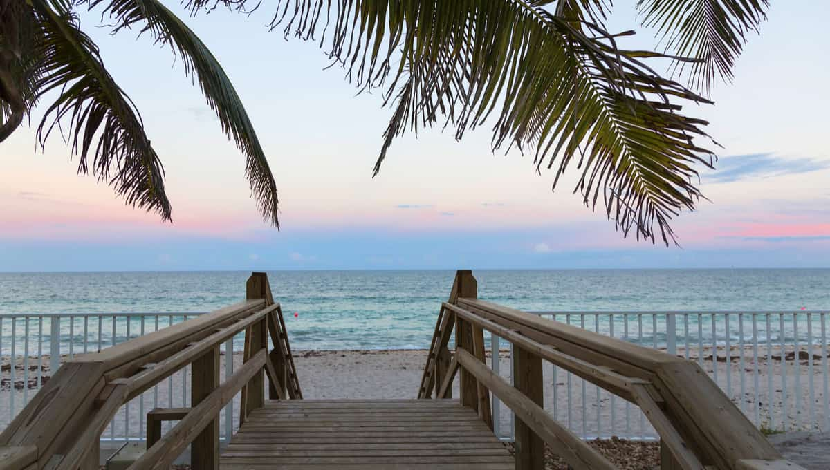 Wooden_stairs_on_deserted_beach_dunes_in_Vero_Beach_Florida_terrenosnaflorida-com_shutterstock_497119957_1200x680